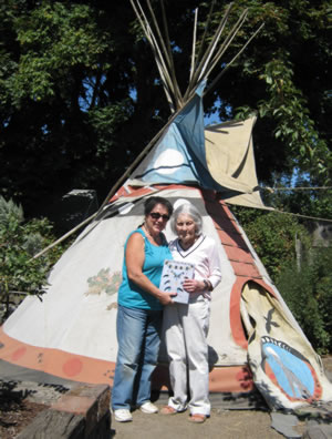 Winkie and D. Vail in front of D. Vails teepee